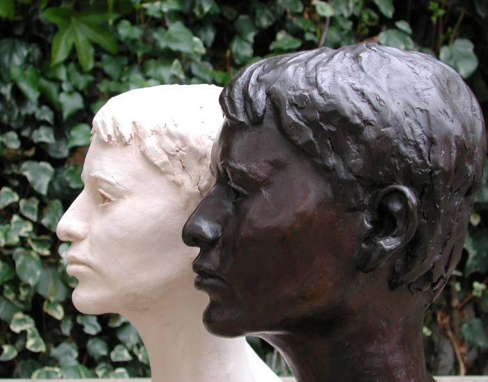 Bronze bust and terra cotta bust side by side