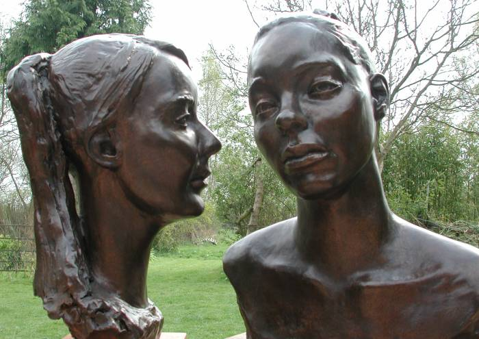 Two bronze busts of sisters in Bristol