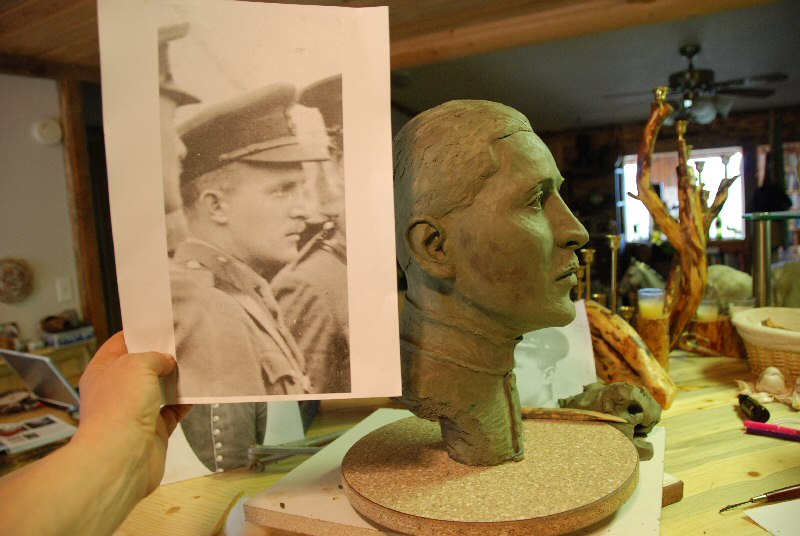 The clay bust in progress and another photograph used to create the clay bust, a commission for the Toronto Airport Authority